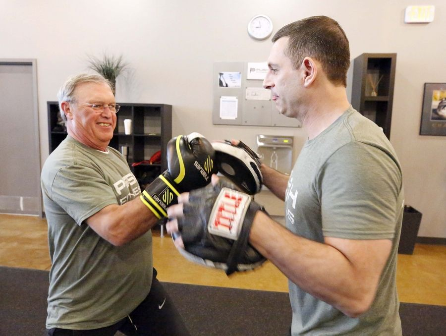 """After you run, box, or lift weights, your body feels so much more energized. You're not tired. You want to keep doing more."" says contestant Bob Sinclair, here boxing with trainer Steve Amsden."