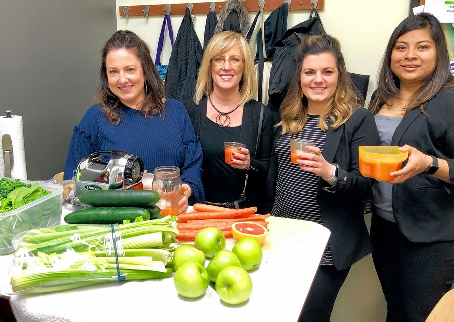 "Team member Shannon Garcia demonstrates how to use a juicer to her team ""Cut it Out"" from Salon Lorrene. From left to right, Shannon Garcia, Lorrene Conino, Ashley Hanus, and Arisbeth Monesinos."
