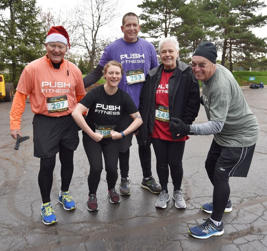 2019 Fittest Loser participants Ed Poczatek, left, Kat Polomsky, Rick Meyers, Annamarie McMurray and Bob Sinclair, right, pose before the Human Race 5K in Downers Grove.