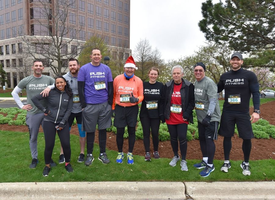 2019 Fittest Loser contestants and their trainers pose before the Human Race 5K in Downers Grove.