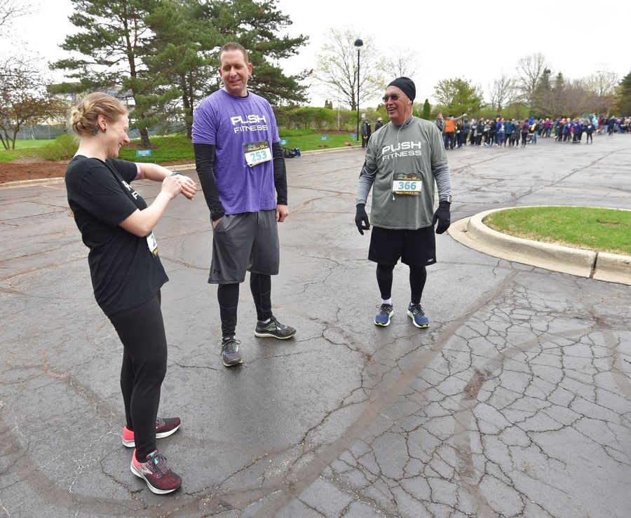 Columnist Kat Polomsky, and contestants Rick Meyers and Bob Sinclair, right, relax before the Human Race 5K in Downers Grove.