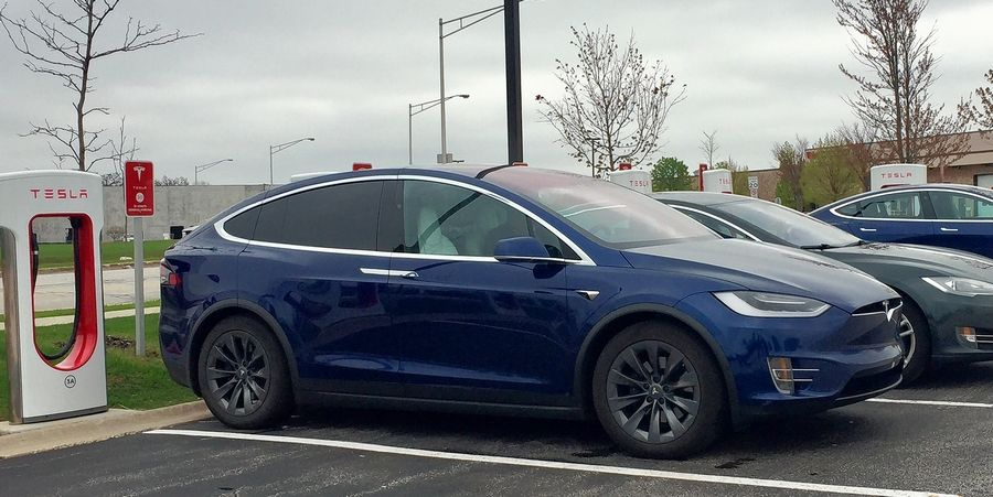 Drivers charging their Teslas at a facility in Rolling Meadows had doubts about proposed legislation to raise rates for electric car vehicle registration in order to help fund transportation.