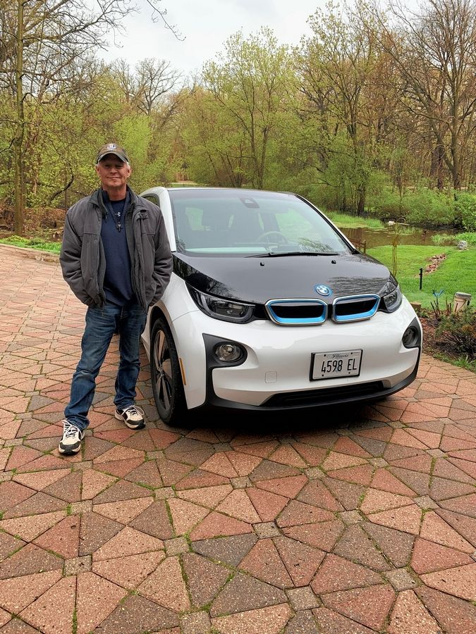 Kevin Brewner of St. Charles owns an electric BMW i3 Rex and has questions about proposed increases in vehicle registration.