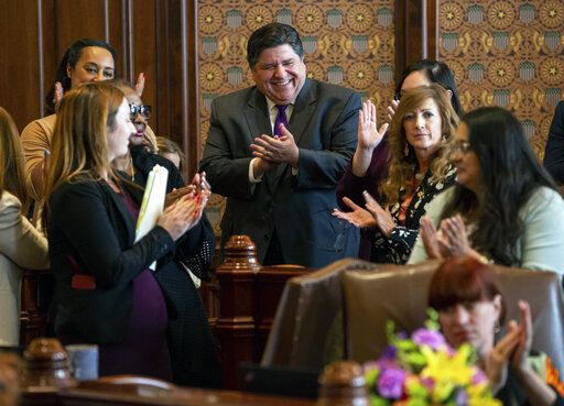 Illinois Governor J.B. Pritzker cheers as Illinois Senate President John Cullerton, D-Chicago, gives his final remarks on the floor of the Illinois Senate during overtime of the Spring Session at the Illinois State Capitol, Sunday, June 2, 2019, in Springfield, Ill. The Illinois Senate approved funding for the capital construction plan, legalized sports betting and gambling expansion. (Justin L. Fowler/The State Journal-Register via AP)