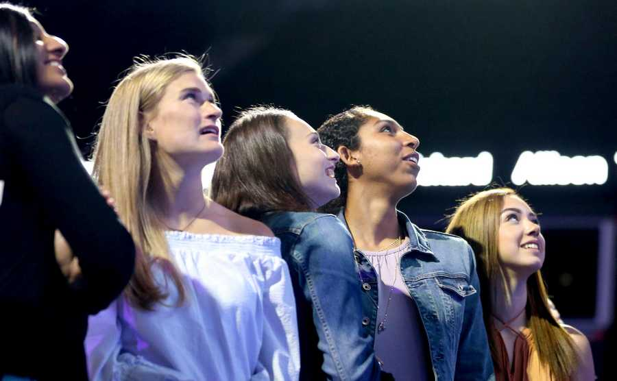 Members of the Class 4A state champion Maine West girls basketball team watch as a highlight video is shown during the Daily Herald Prep Sports Excellence Awards at Sears Centre Arena in Hoffman Estates on Thursday night. The team was awarded a Sweet Moments Award at the event.