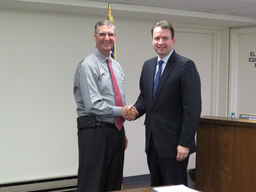 Bloomingdale Township Supervisor Michael D. Hovde Jr. welcomes Marco Parducci, left, as a new member of the township mental health board.