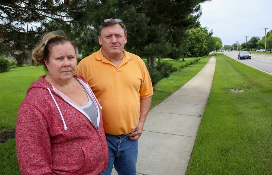 Tom and Cathy Verdone are upset with plans to expand the intersection of Book Road and 95th Street in Naperville in an effort to improve traffic flow and safety. They said they stand to lose a line of hedges if Book Road is expanded, and they fear a larger road would only draw more drivers trying to avoid other busy north/south streets.