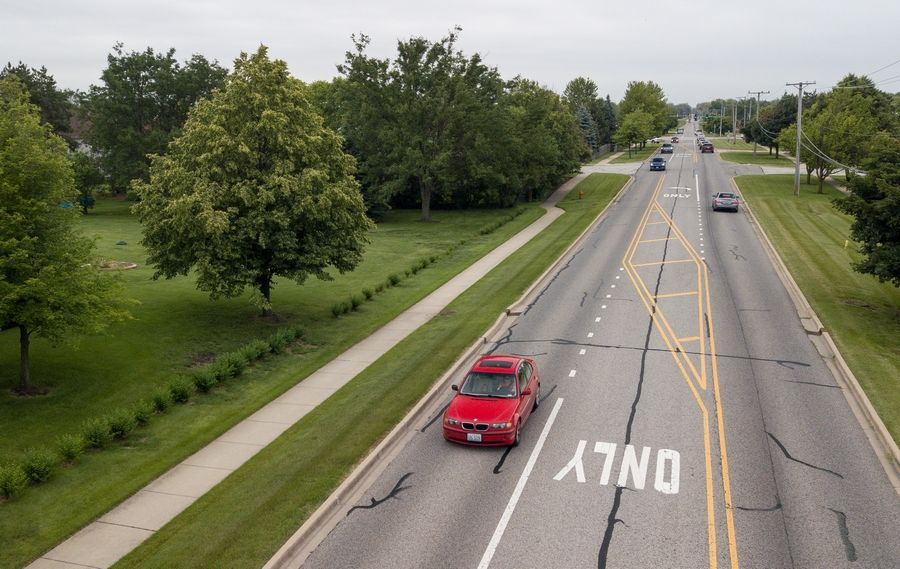 Book Road in Naperville may be expanded to include two north/south lanes and dedicated right-turn lanes at all four corners of its intersection with Book Road, if the city council approves a plan suggested by city staff members to improve traffic and safety.