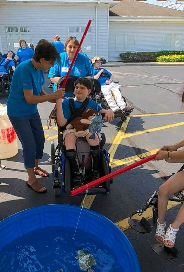 The annual Summer Games, Marklund's version of the Special Olympics, features residents competing in outdoor events with the help of volunteers.