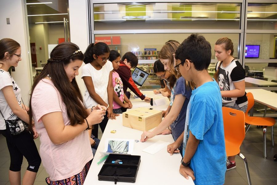 "Teens try to solve clues in an escape room event at the Schaumburg Township Library. The next teen escape room will feature clues based on the hit series, ""Stranger Things."" See article for details. Susan Miura"
