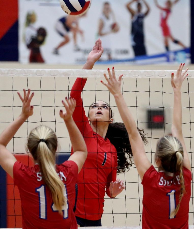 South Elgin's Angelina Negron hits the ball against Glenbard South at South Elgin Tuesday night.