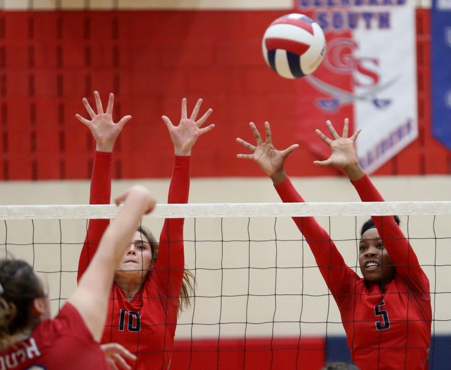 South Elgin's Brooke Elders, left, and Loreal Wilson block against Glenbard South in varsity girls volleyball at South Elgin Tuesday night.
