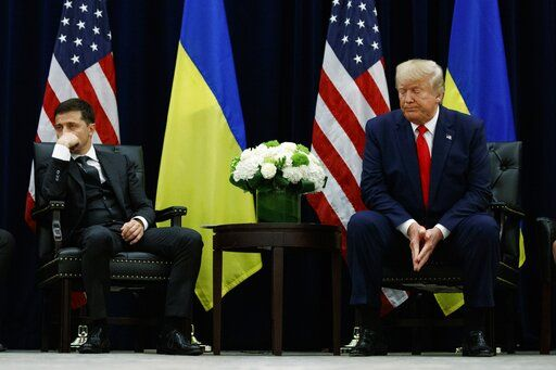 FILE - In this Wednesday, Sept. 25, 2019 file photo, President Donald Trump meets with Ukrainian President Volodymyr Zelenskiy at the InterContinental Barclay New York hotel during the United Nations General Assembly, in New York. Ukraine's president appears to be playing to both sides of the U.S. political divide, hedging his bets to ensure U.S. financial and military aid keeps flowing no matter who wins next year's election.