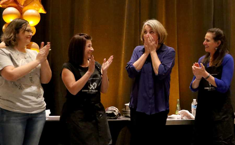 Leslie Meredith of Arlington Heights reacts after her name is called as the Daily Herald Cook of the Week Challenge Finale winner at the Westin in Itasca on Monday evening. From left are finalists Lulu Chapa of Volo, Lisa Eberhahn of Mount Prospect, Meredith, and Ann Wayne of Barrington.