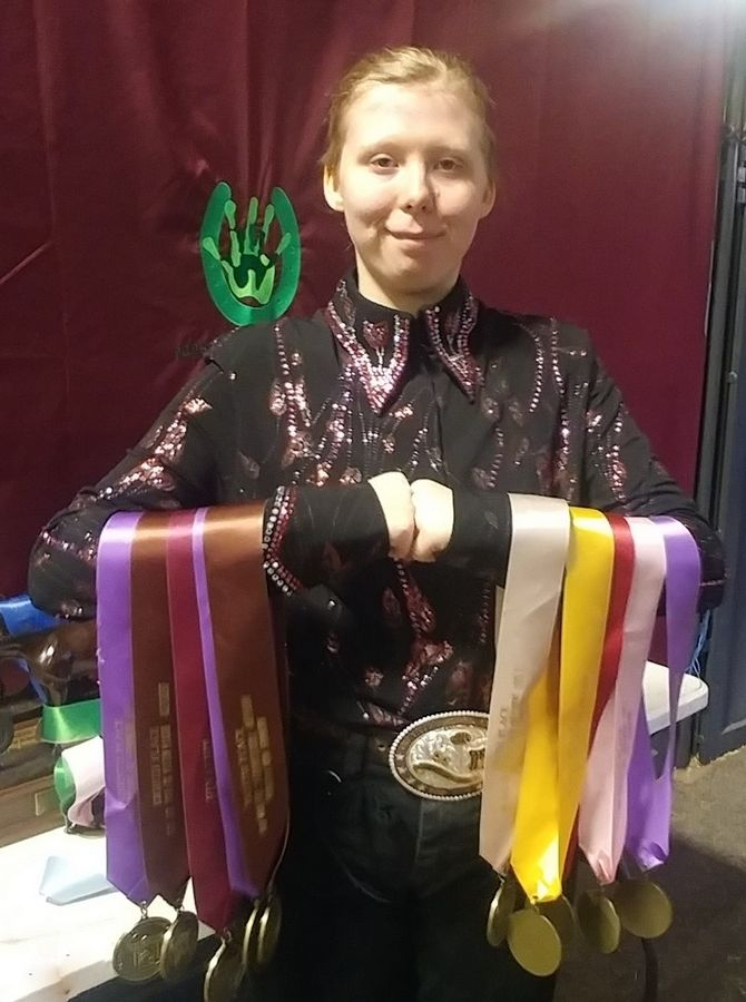 Rhiannon Huffman of Antioch shows off her winning medals from the Congress Horse Show.