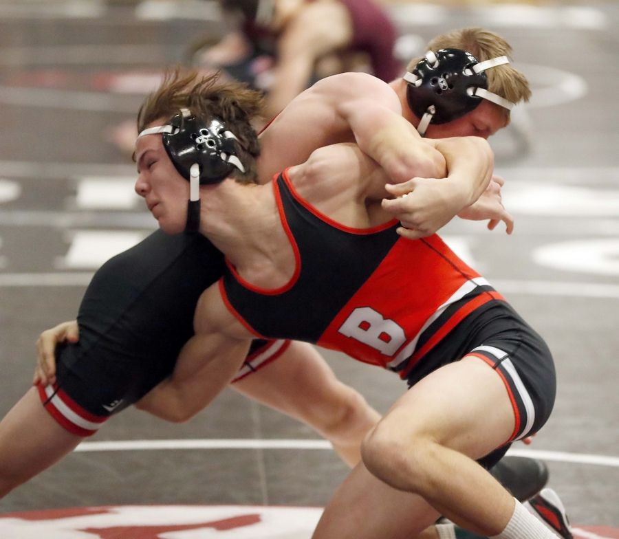 Joe Mc Dermott of Bolingbrook (front) wrestles Phillip Chapa of Barrington at 120 pounds Saturday during the Moore-Prettyman wrestling tournament at Barrington High School.