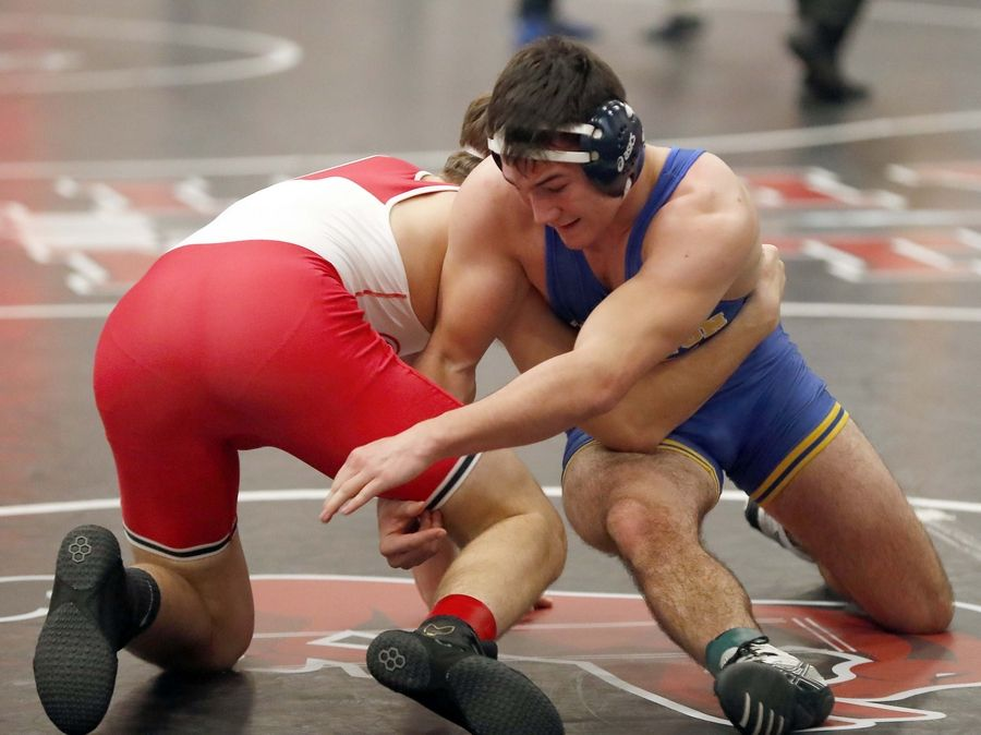 Ethan Geist of Grant (left) wrestles Nathan Love of Wheaton North at 182 pounds Saturday during the Moore-Prettyman wrestling tournament at Barrington High School.