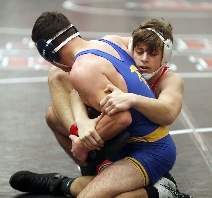 Ethan Geist of Grant (right) wrestles Nathan Love of Wheaton North at 182 pounds Saturday during the Moore-Prettyman wrestling tournament at Barrington High School.