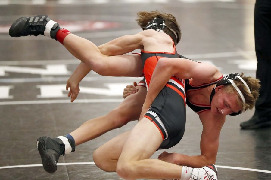 Joe Mc Dermott of Bolingbrook wrestles Phillip Chapa of Barrington (sideways) at 120 pounds Saturday during the Moore-Prettyman wrestling tournament at Barrington High School.