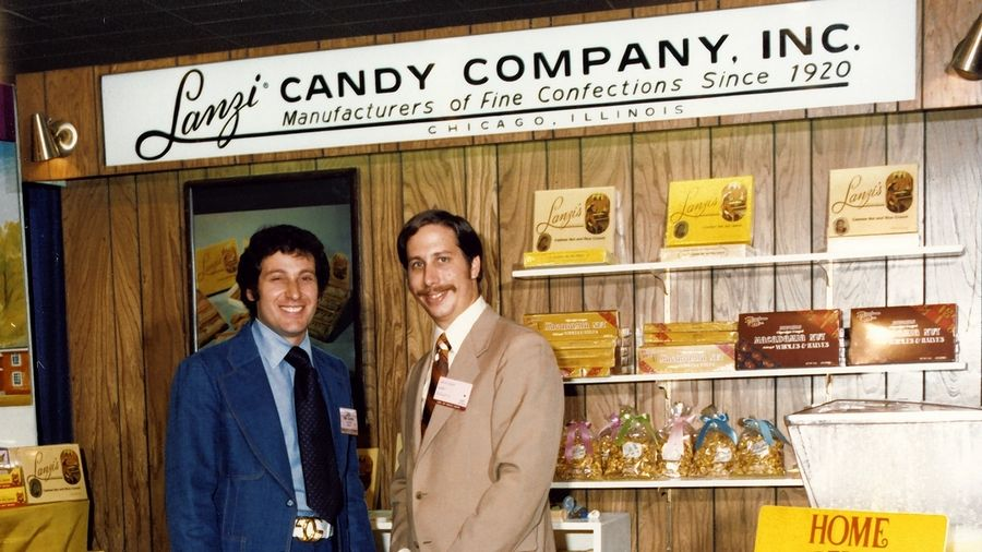 Arlen Gould, from right, and Larry Zaslavsky are pictured at a trade show in the 1970s after purchasing Lanzi Candy Co. A new documentary details the history of the former Chicago candy company.