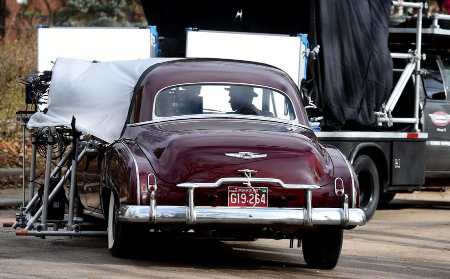 "A burgundy Chevrolet is towed and filmed turning on North Street in Elgin as crews shoot scenes for the FX series ""Fargo"" Monday."