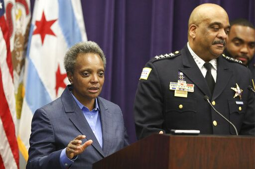 "FILE - In this Nov. 7, 2019 file photo, Mayor Lori Lightfoot speaks as Chicago Police Superintendent Eddie Johnson announces his retirement after more than three years leading the department in Chicago. Mayor Lightfoot  fired Police Supt. Eddie Johnson Monday Dec. 2, 2019, due to his ""ethical lapses."""