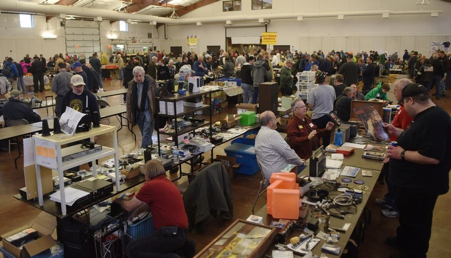 Customers visit sellers' tables during the Wheaton Hamfest, featuring ham radio, computer, radio control and hobby electronics vendors, at the Kane County Fairgrounds in St. Charles.
