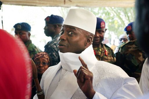 FILE - In this Thursday, Dec. 1, 2016 file photo, Gambia's President Yahya Jammeh shows his inked finger before voting in Banjul, Gambia.  Gambia's longtime dictator Yahya Jammeh, who fled into exile three years ago after an election loss, says he wants to return home, according to an audio recording released by his political party Tuesday Jan. 14, 2020.