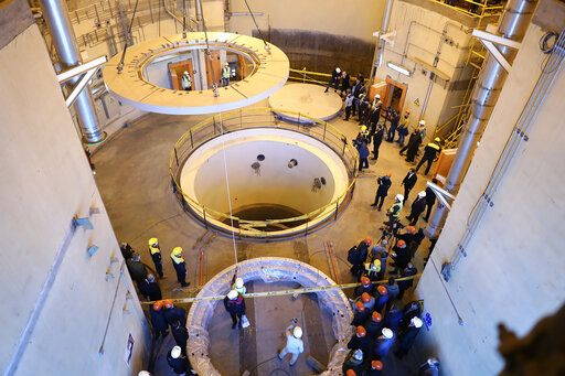 FILE - In this Dec. 23, 2019 file photo released by the Atomic Energy Organization of Iran, technicians work at the Arak heavy water reactor's secondary circuit, as officials and media visit the site, near Arak, Iran. Britain, France and Germany said Tuesday Jan. 14, 2020, they are triggering a dispute mechanism that is part of the nuclear deal with Iran over its failure to live up to terms of the pact. (Atomic Energy Organization of Iran via AP, File)