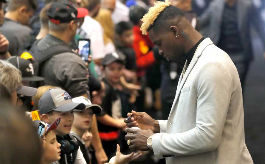 Luis Robert signs autographs for youngsters during opening day of SoxFest at McCormick Place West in Chicago on Friday.