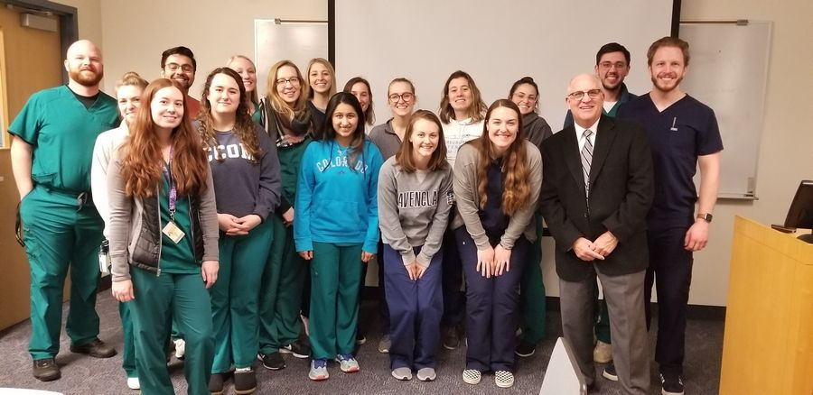 Midwestern University medical students learn more about the work done by DuPage County Coroner Dr. Richard Jorgensen.