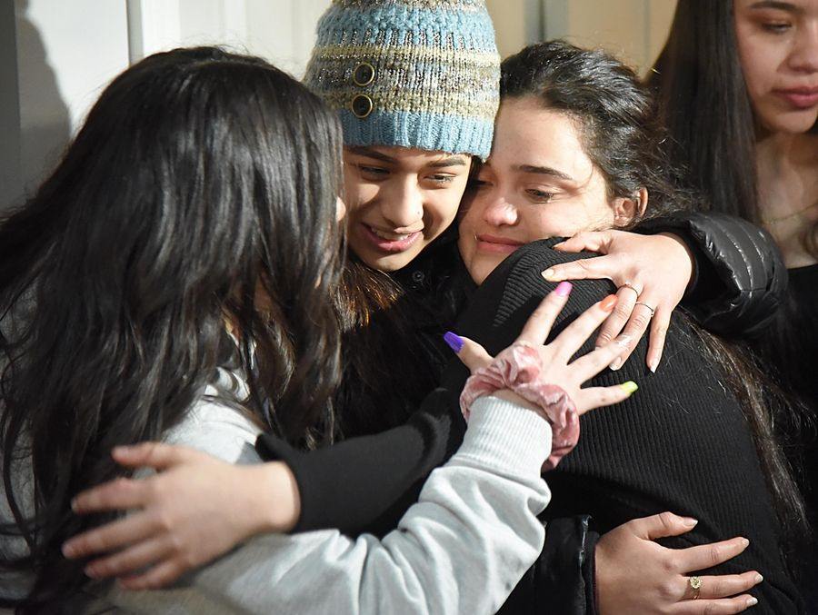 AT DAILYHERALD.COM/VIDEO: Meydi Guzman Rivas, right, a Crystal Lake Central High School senior who spent four months in ICE detention, hugs friends Thursday as she is welcomed back at the home of school counselor Sara Huser.