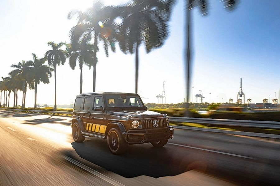 The black metallic Cigarette Edition Mercedes-AMG G 63 cruise down a Miami highway.