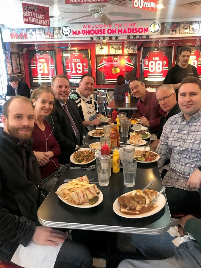 "Brandon Cain, Tracey Myers, Chris Kuc, Palace owner George Lemperis, John Dietz, Mike ""Doc"" Emrick and Scott King dig in March 11 at the Palace Grill near the United Center. Emrick, a prostate cancer survivor, treated the group during his annual Cancer Survivors lunch. The next day the NHL would suspend its season due to coronavirus."