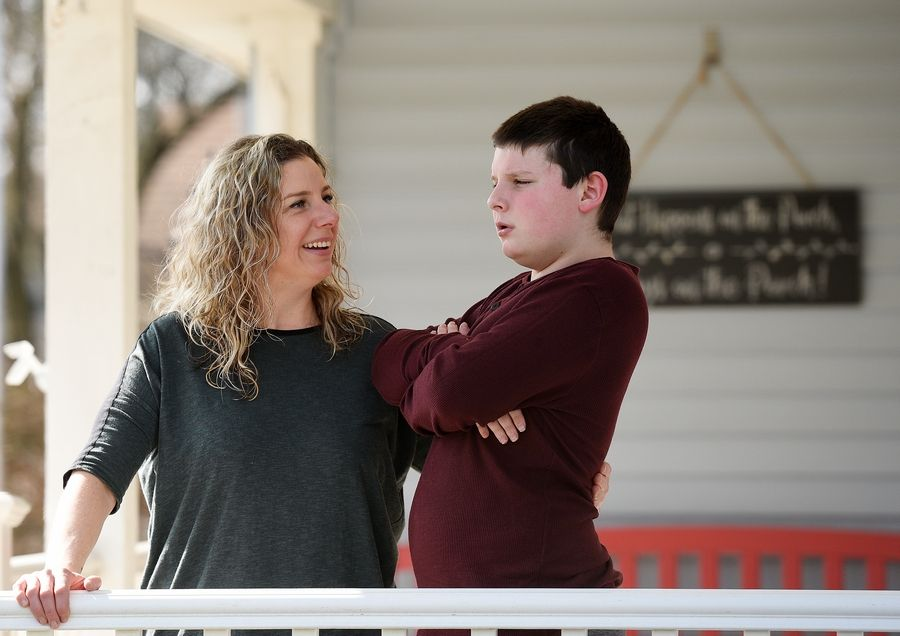 Dana Hall, of Naperville, is struggling to support her 11-year-old son Keller, who is severely autistic and nonverbal, while schools are closed. Keller attends an out-of-district therapeutic day school, Helping Hand in Countryside.