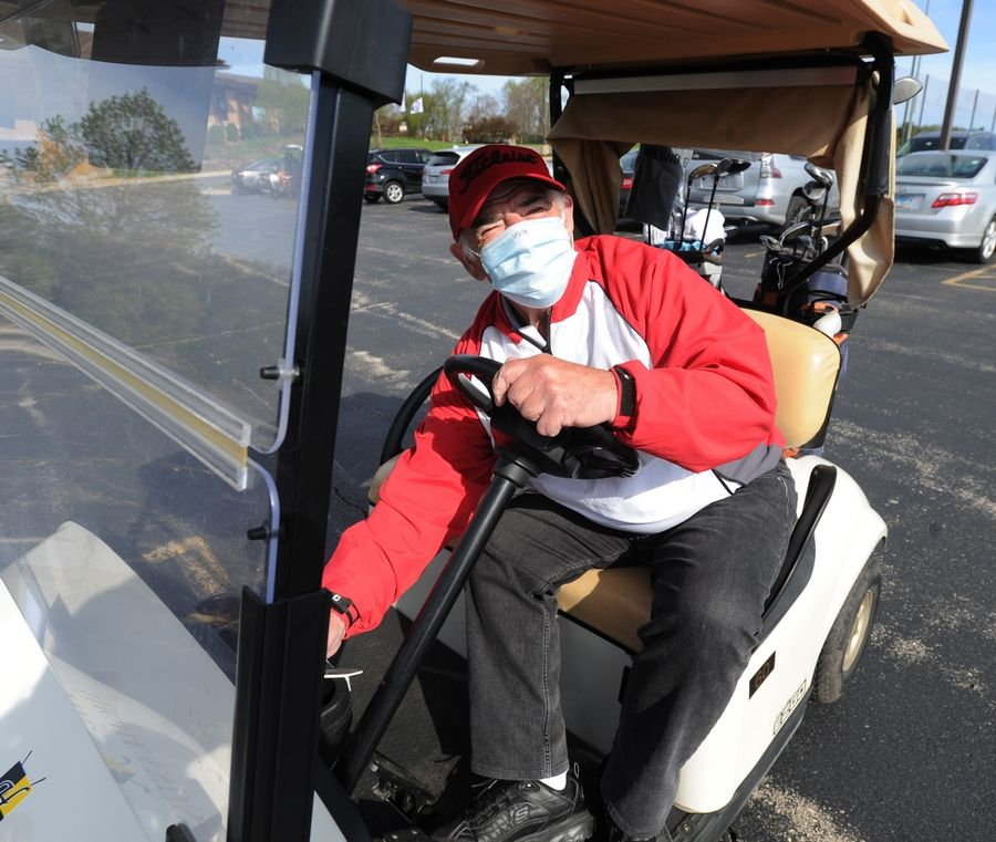 Rocco Casamassimo of South Elgin fires up his golf cart Wednesday at The Highlands of Elgin golf course.