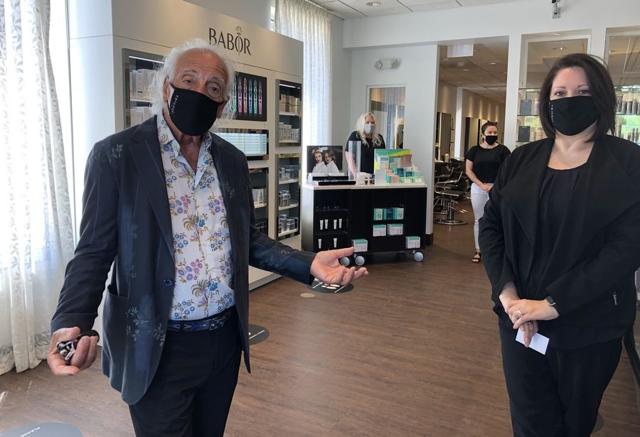 Mario Tricoci and General Manager Jennie Bubloni at the Mario Tricoci Hair Salon & Day Spa in Libertyville. The state's COVID-19 stay-at-home order eased Friday and businesses, including salons, were allowed to open with restrictions.