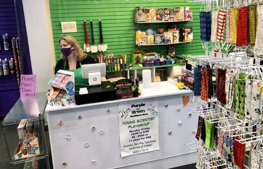 Mary Stupen of Palatine is co-owner of Purple Me Green, The Science Store in Woodfield Mall in Schaumburg. Safety measures are in place at the register and the store now sells cloth masks. Purple Me Green reopened Friday. The state's COVID-19 stay-at-home order eased Friday and businesses were allowed to open with restrictions.
