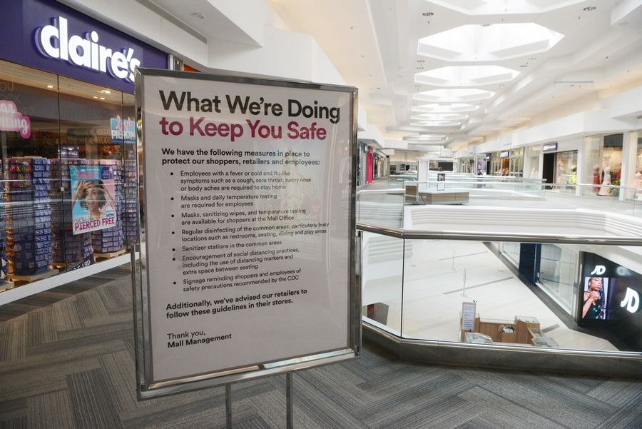 Signage in place Friday before to the reopening of Woodfield Mall in Schaumburg. The state's COVID-19 stay-at-home order eased Friday and businesses were allowed to open with restrictions.