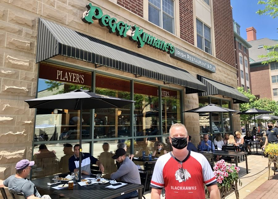 Derek Hanley, owner of Peggy Kinnane's Irish Restaurant & Pub in downtown Arlington Heights, welcomed back his customers for outdoor dining service Friday. The state's COVID-19 stay-at-home order eased Friday and businesses, including restaurants, were allowed to open with restrictions.
