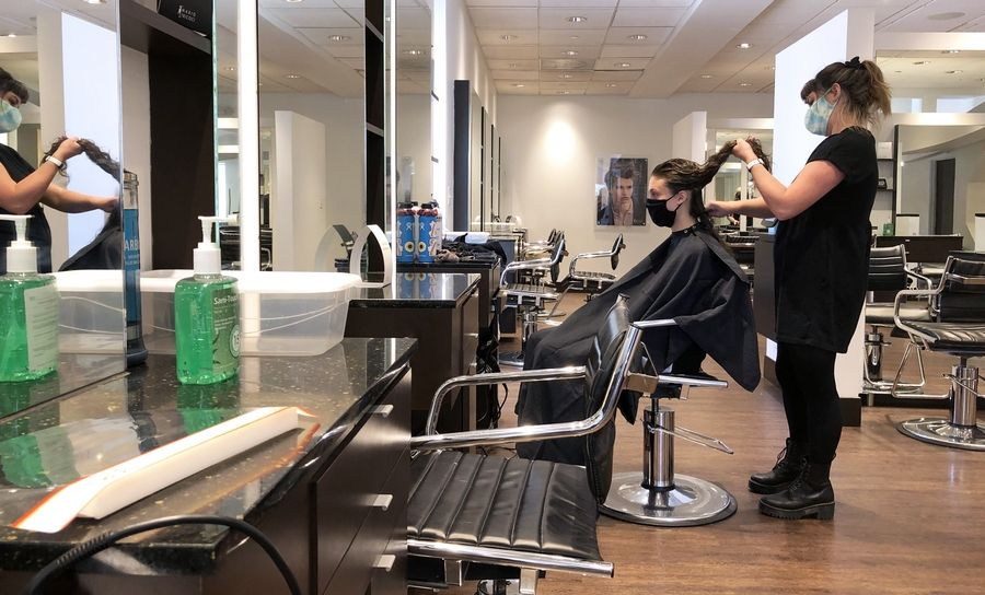 Stylist Kerry Ryan gives Ashley Adams a smoothing treatment at Mario Tricoci Hair Salon & Day Spa in Libertyville. The state's COVID-19 stay-at-home order eased Friday and businesses, including salons, were allowed to open with restrictions.