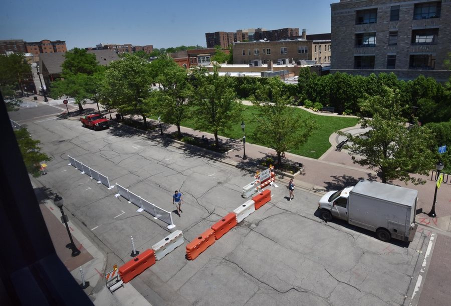 Barricades were set up on Vail Avenue and Campbell Street in downtown Arlington Heights on Tuesday in anticipation of the opening of the village's Arlington Alfresco outdoor dining program on Wednesday.