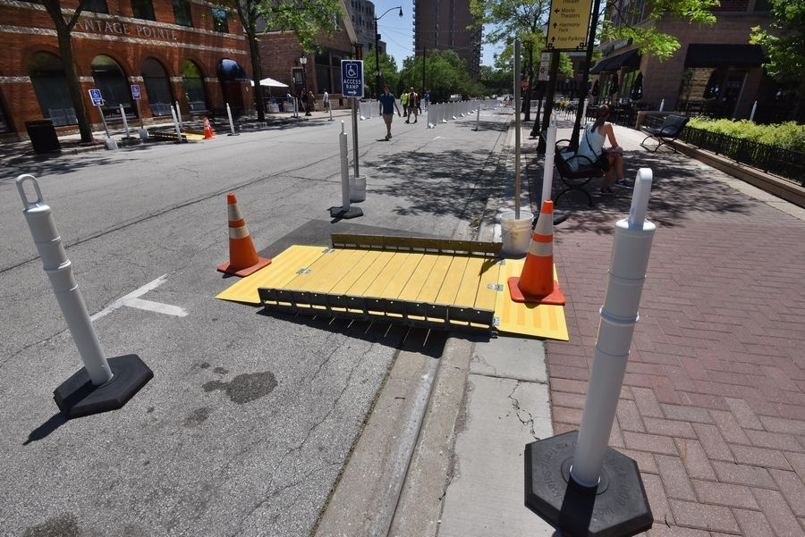 Pedestrian ramps were set up Tuesday on Vail Avenue and Campbell Street in downtown Arlington Heights after the thoroughfares were closed to vehicle traffic. The village coordinated the street closures to allow restaurants to expand their outdoor dining capacities starting Wednesday night.