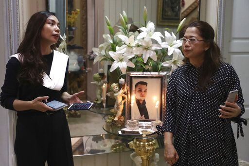 Fiance Tri Novia Septiani, left, and mother Herlina Simbala of Dr. Michael Robert Marampe attend an online memorial service to mark the 40th day since Marampe passed away due to COVID-19 in Jakarta, Indonesia, on June 5, 2020. Marampe knew what he wanted to be since he was a kid: a doctor and a pianist. He became both, and his passion for music even led him to Septiani - a woman he never got to marry because he got the coronavirus. Marampe became one of dozens of doctors the coronavirus has claimed so far in Indonesia.