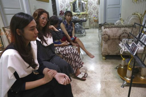 Fiance Tri Novia Septiani, left, and mother Herlina Simbala, second from left, of Dr. Michael Robert Marampe attend an online memorial service to mark the 40th day since Marampe passed away due to COVID-19 in Jakarta, Indonesia, on June 5, 2020. Marampe knew what he wanted to be since he was a kid: a doctor and a pianist. He became both, and his passion for music even led him to Septiani - a woman he never got to marry because he got the coronavirus. Marampe became one of dozens of doctors the coronavirus has claimed so far in Indonesia.