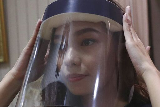 Tri Novia Septiani fixes her face shield while she attends an online memorial service for her fiance Dr. Michael Robert Marampe, to mark the 40th day since Marampe passed away due to COVID-19 in Jakarta, Indonesia, on June 5, 2020. Marampe knew what he wanted to be since he was a kid: a doctor and a pianist. He became both, and his passion for music even led him to Septiani - a woman he never got to marry because he got the coronavirus. Marampe became one of dozens of doctors the coronavirus has claimed so far in Indonesia.