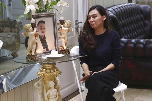 Tri Novia Septiani cries next to a portrait of her fiance Dr. Michael Robert Marampe, during an online memorial service to mark the 40th day since Marampe passed away due to COVID-19 in Jakarta, Indonesia, on June 5, 2020. Marampe knew what he wanted to be since he was a kid: a doctor and a pianist. He became both, and his passion for music even led him to Septiani - a woman he never got to marry because he got the coronavirus. Marampe became one of dozens of doctors the coronavirus has claimed so far in Indonesia.