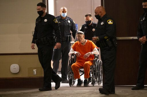 Sacramento County Sheriff's Deputies use a wheelchair to bring Joseph James DeAngelo into the courtroom in Sacramento Superior Court in Sacramento, Calif. Monday, June 29, 2020. DeAngelo, 74, pleaded guilty to 13 counts of murder and multiple other charges 40 years after a sadistic series of assaults and slayings in California. Due to the large numbers of people attending, the hearing was held at a ballroom at California State University, Sacramento to allow for social distancing.