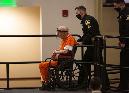 Joseph James DeAngelo, charged with being the Golden State Killer, is wheeled into the courtroom in Sacramento, Calif., Monday, June 29, 2020. DeAngelo, 74, pleaded guilty to multiple counts of murder and other charges 40 years after a sadistic series of assaults and slayings in California. Due to the large numbers of people attending, the hearing was held at a ballroom at California State University, Sacramento to allow for social distancing.