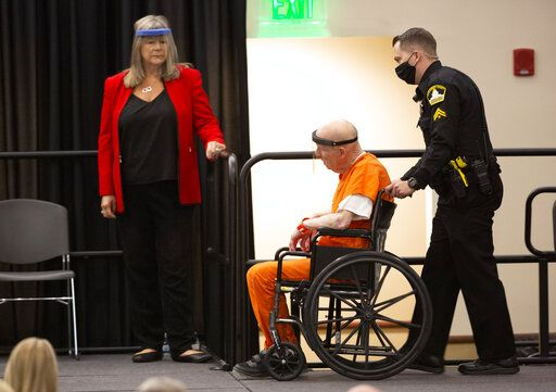 Joseph James DeAngelo, charged with being the Golden State Killer, is wheeled into the courtroom as his attorney, public defender Diane Howard, left, looks on in Sacramento, Calif., Monday June 29, 2020. DeAngelo, 74, pleaded guilty to multiple counts of murder and other charges 40 years after a sadistic series of assaults and slayings in California. Due to the large numbers of people attending, the hearing was held at a ballroom at California State University, Sacramento to allow for social distancing.